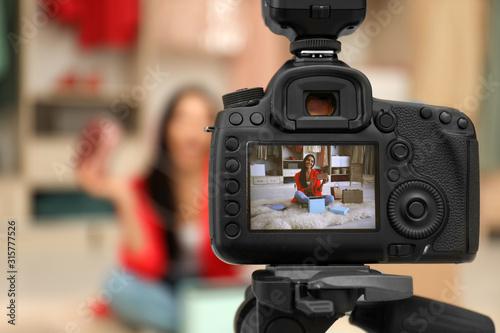 Fototapeta Fashion blogger recording new video in room, focus on camera obraz na płótnie