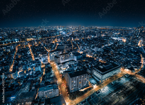 Fotografie, Tablou  Aerial Drone View of Futuristic City Skyline with Starry Night Sky in Tokyo, Jap