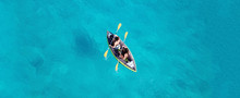 Aerial Drone Ultra Wide Photo Of 2 Unidentified Fit Women Canoeing In Tropical Caribbean Exotic Destination With Turquoise Sea