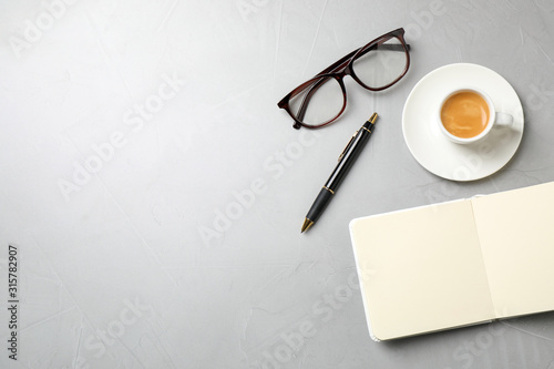 Obraz Flat lay composition with coffee on grey table, space for text. Tasty breakfast - fototapety do salonu