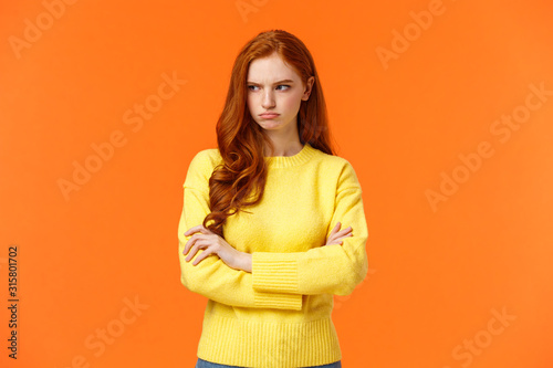 Fotografia, Obraz Offended angry and tensed woman with curly red hair, freckles, having bad mood,