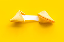 Fortune Cookie - Broken Piece With Prediction Inside - On Yellow Background Copy Space