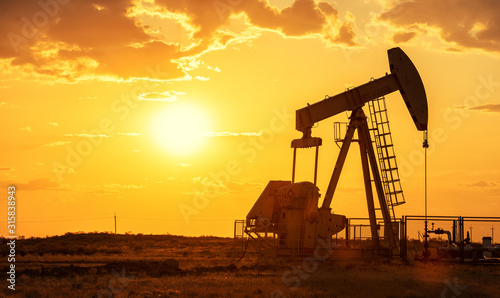 Obraz Oil pump oil rig energy industrial machine for petroleum in the sunset background - fototapety do salonu