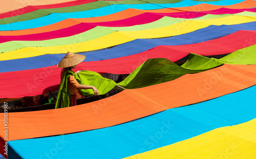 Handcrafted colorful lotus fabrics made from lotus fibers in Inle Lake, Shan State in Myanmar Wallpaper Mural