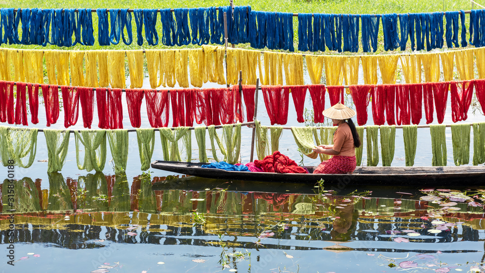 Fototapeta Handcrafted colorful lotus fabrics made from lotus fibers in Inle Lake, Shan State in Myanmar. These Inle handcrafted lotus fabrics are made using natural dyes and dried under sunlight.