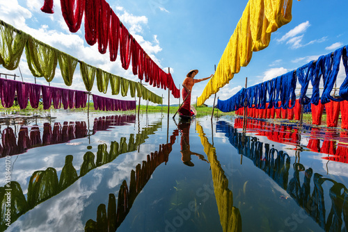 Fototapeta Handcrafted colorful lotus fabrics made from lotus fibers in Inle Lake, Shan State in Myanmar