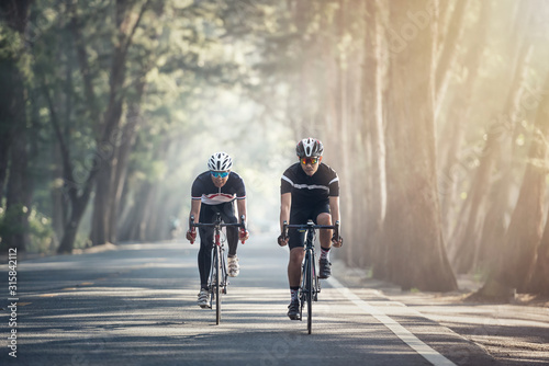Obraz na plátně Asian men are cycling road bike in the morning