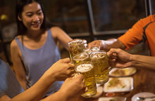 Group Of Friends Drink Beer Du...