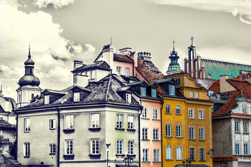 Fototapeta Vintage Colorful houses in the old town in Warsaw at the castle square. Old retro vintage style photo.