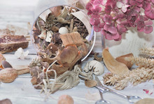 Potpourri Spilled On A Table With Dry Flowers And Pair Of Scissors