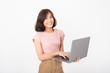 Cute Asian teen woman is working with computer on white background