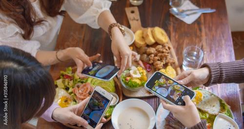 Fotografie, Obraz Asian Woman Chatting In Restaurant