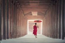 Novice Monks Walking On Ancien...