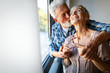 canvas print picture Happy smiling senior couple embracing together at home