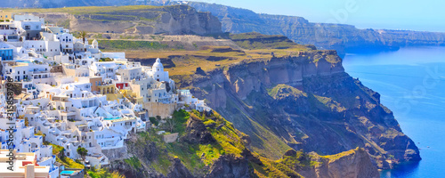 Fototapeta Santorini town Fira, Greece banner panorama with white houses and high volcanic rocks and blue sea obraz