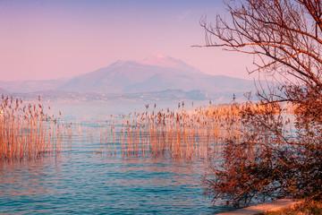 Panel Szklany Wschód / zachód słońca Early morning. Sunrise over the lake. Garda lake (Lago di Garda), Italy, Europe