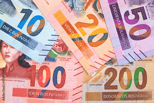 Fotografering  Bolivian money - Boliviano a business background