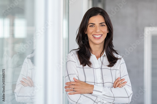 Successful mature business woman looking at camera - 315860575