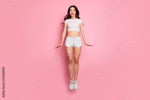 Full length body size view of her she nice attractive lovely charming slender thin cheerful funky cheery wavy-haired girl jumping up having fun isolated over pink pastel color background - 315860912