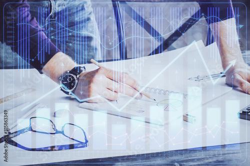 Fototapeta Financial trading chart double exposure with man desktop background. obraz