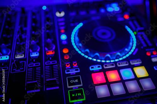 Fototapeta  closeup view of a DJ's mixing desk