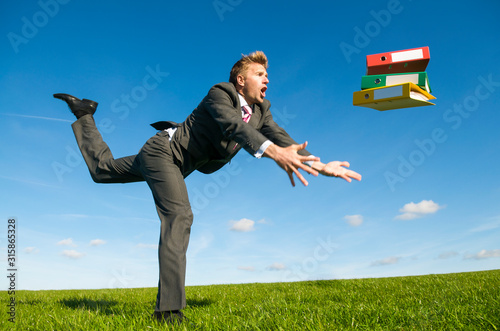 Valokuvatapetti Clumsy businessman tripping dramatically with his file folders flying outdoors i