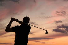 Golfer Swinging A Golf Club Si...