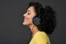 Profile Of A Woman Listening M...
