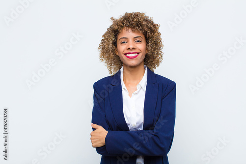 Photo young woman african american looking like a happy, proud and satisfied achiever
