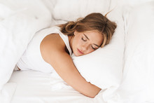 Photo Of Young Caucasian Woman Sleeping And Hugging Pillow