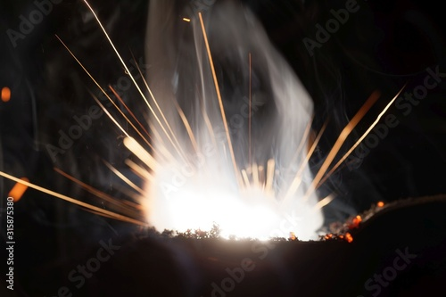 Fotografie, Tablou  Macro photo of bursting gunpowder