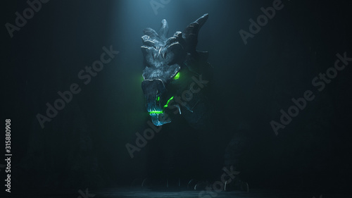 Huge medieval dragon with glowing green eyes and flames in a dark cave Fototapeta