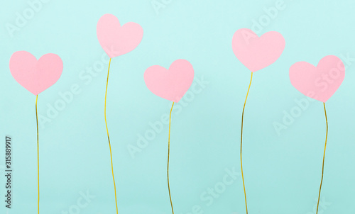 Fototapeta Lot of paper pink hearts and colored golden wire against blue background.Concept of valentine`s day and gifts, cards obraz na płótnie