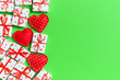 canvas print picture - Top view of gift boxes and red textile hearts on colorful background. St Valentine's day concept with copy space