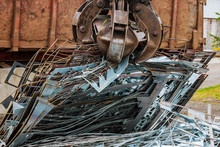 A Grapple Truck Loads Scrap In...