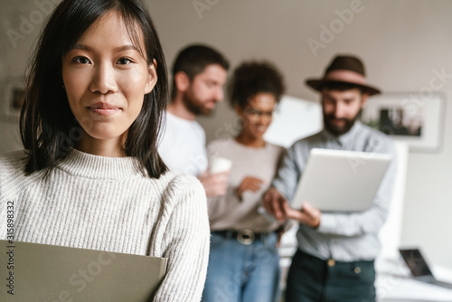 Image of multiethnic young business people working together at office - 315898332