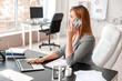 Beautiful businesswoman working in modern office