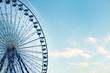 Leinwanddruck Bild -  beautiful blue and white ferris wheel among the clouds