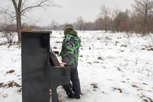 Boy Playing Piano Outdoors