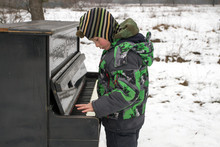 Boy Playing Piano Outdoors