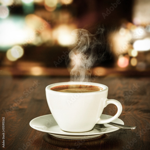Stampa su Tela Fresh hot coffee on wooden table in cafe interior and free space for your decoration