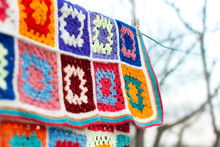 Colorfull Handmade Crochet Blanket Afgan Made From Woolen Granny Squares Hanging Outdoors