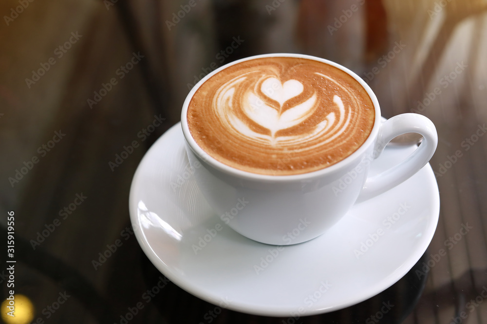 Fototapeta hot latte coffee put on table in cafe restaurant, drink breakfast in the morning day