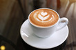 Leinwandbild Motiv hot latte coffee put on table in cafe restaurant, drink breakfast in the morning day