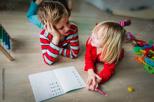 boy and girl learn to count and write numbers Wallpaper Mural