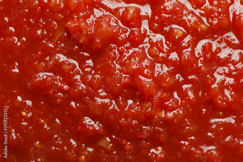 Fototapeta Chili sauce textured background, top view, closeup. Space for text obraz