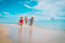 Happy Kids Enjoy Beach Vacatio...