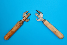 Two Old Rusty Can Openers On A...