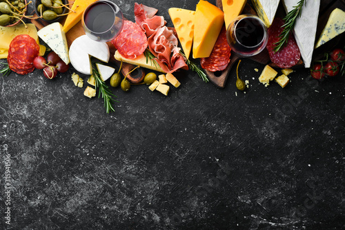Appetizers table with italian antipasti snacks and wine in glasses Canvas Print