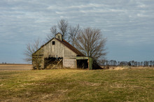 An Abandoned Corn Crib Or Barn With A Lean To On The Side